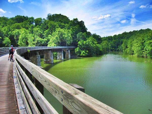 Bridged area of the trail alongside beautiful river scenery