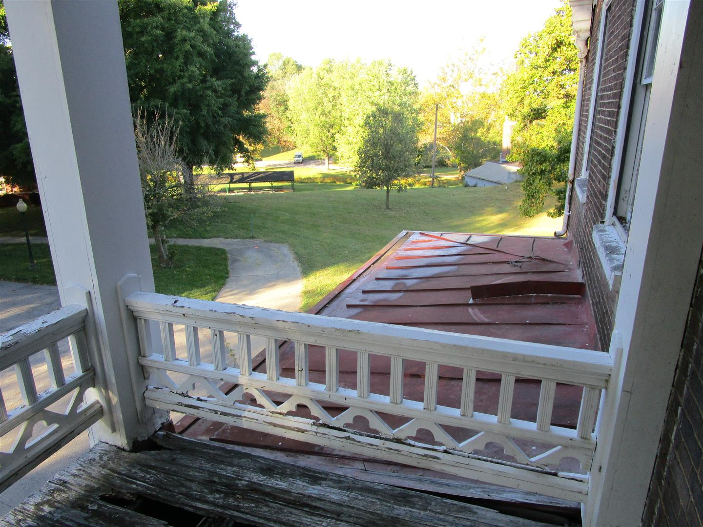 Second Story Balcony Railing and Single Story Porch Roof