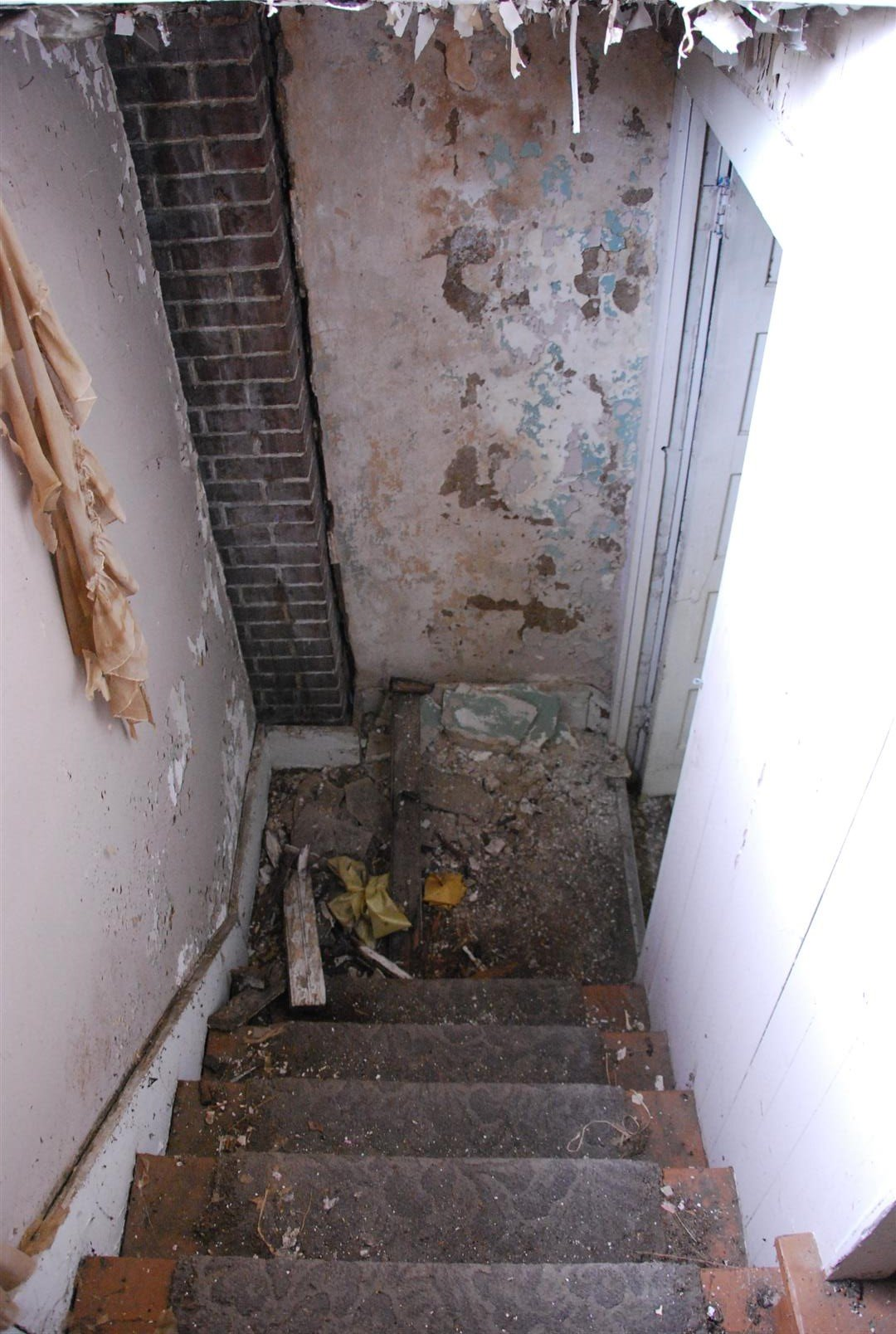 """Rear Stair (Likely not original).  Note brick column in corner (Likely support for two story """"sleeping porch"""" originally)"""