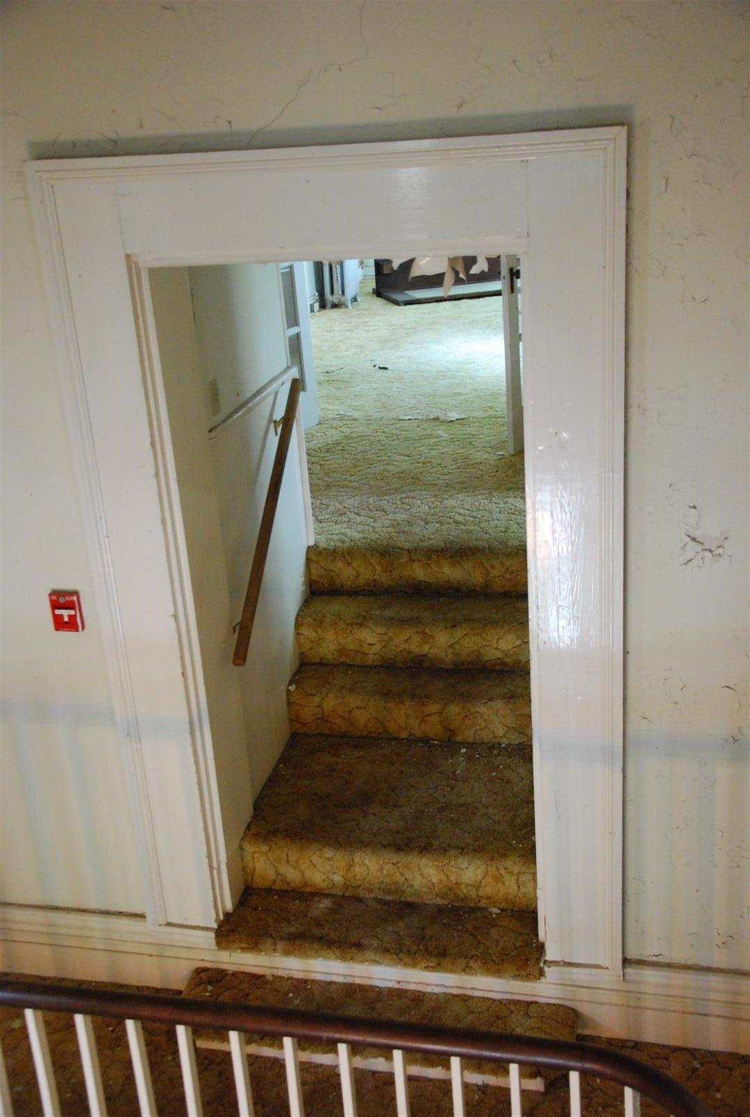 Detail of added stair and Doorway off of Grand Stair Landing.