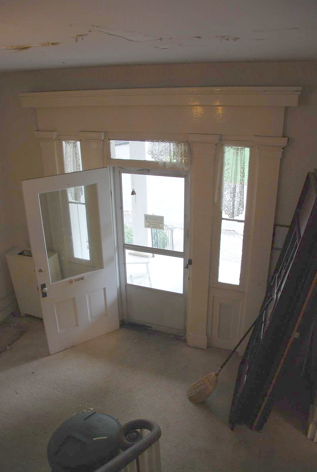 View of Interior Casing, Transom, and Sidelights at First Floor Main Entry.