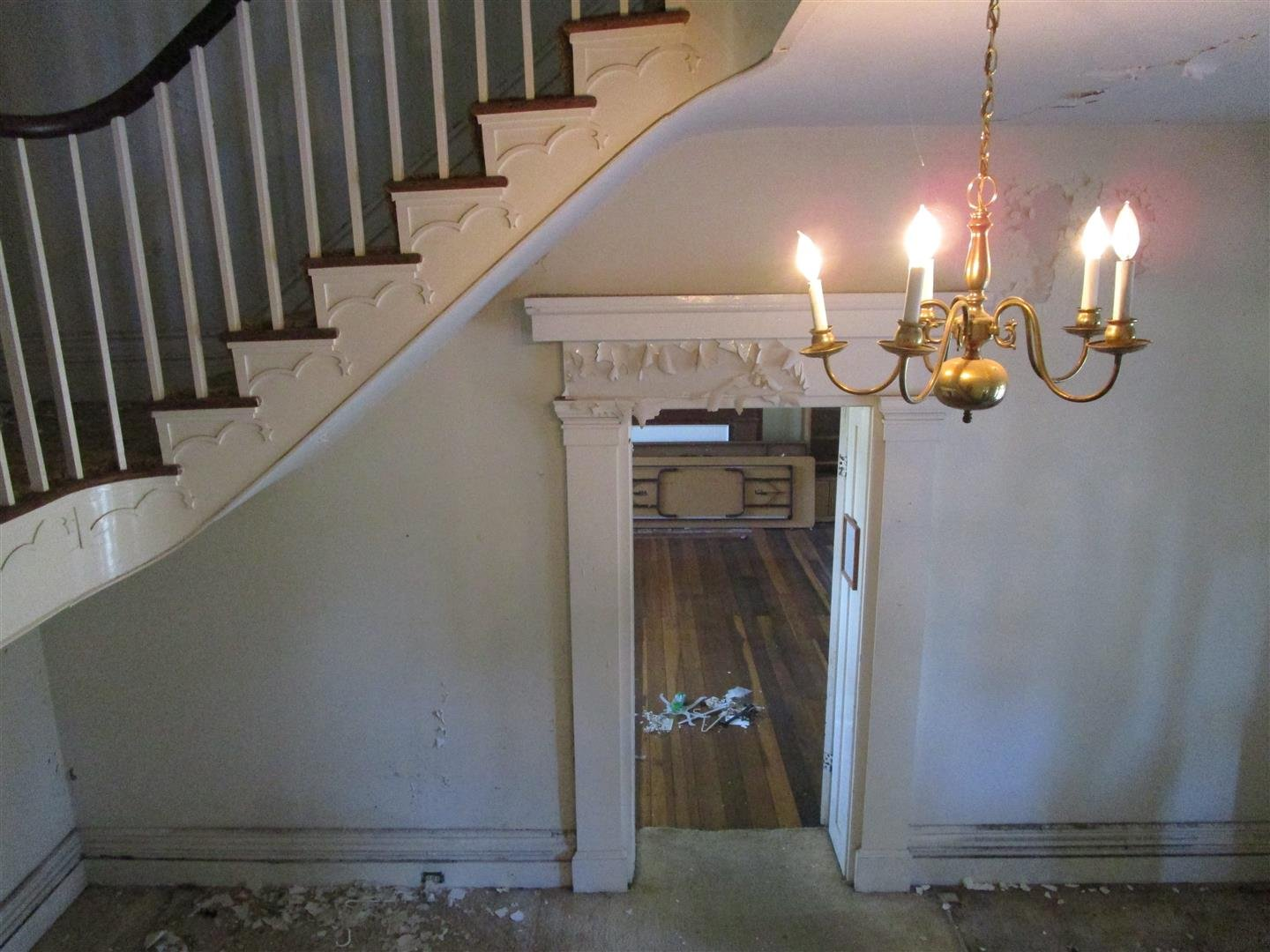 View showing Cantilevered Grand Stair and Decorative Door Casing in Main Hall.