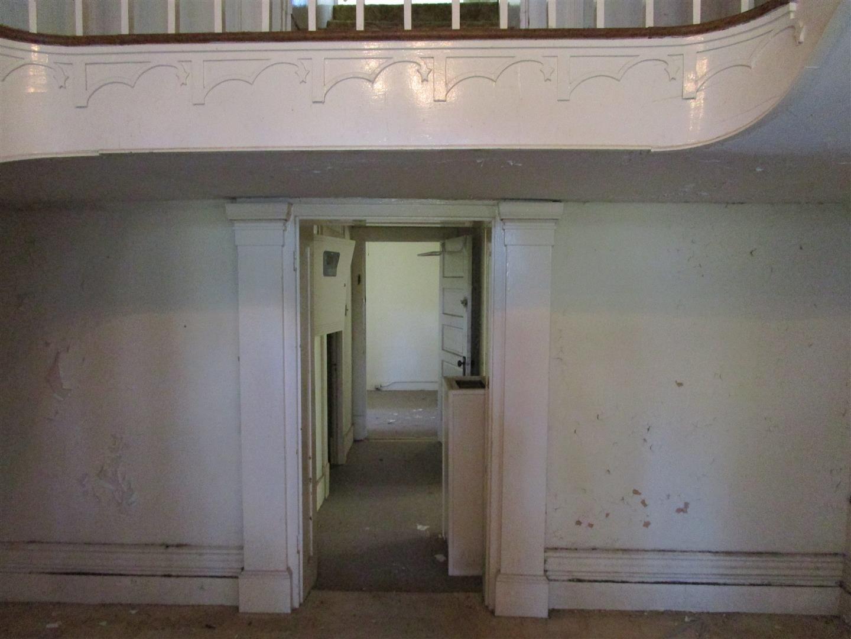 View through Main Hall.  (Likely originally an exterior door exiting onto 2 story sleeping porch)