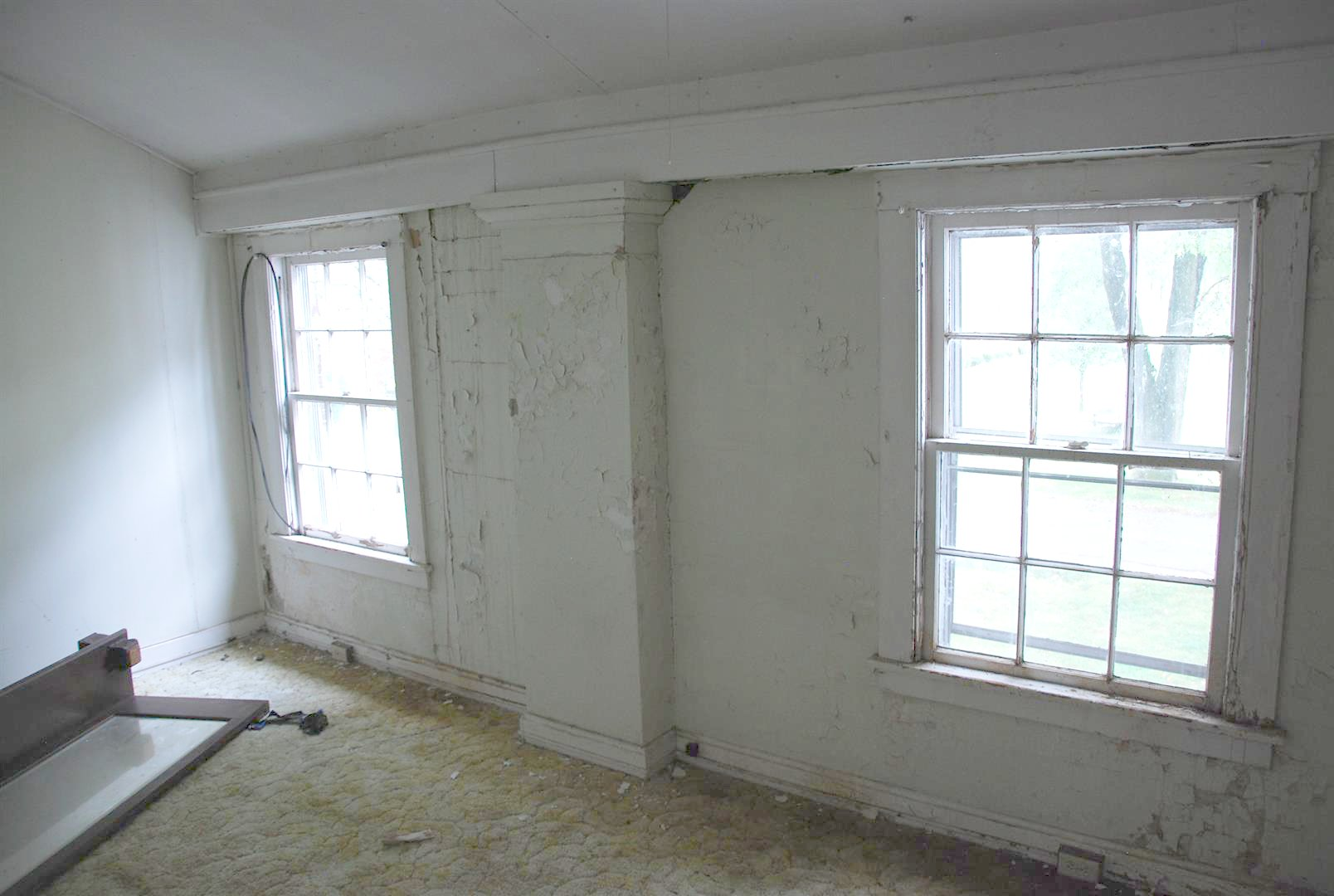 Added Wall construction and windows Between Support Columns at Second Floor to enclose Sleeping Porch)