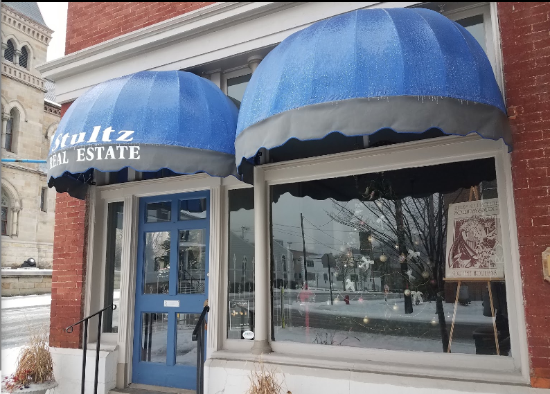 The building is now Shultz Real Estate, but it was originally the home of ______, who had some connection to the Hollidaysburg canals.