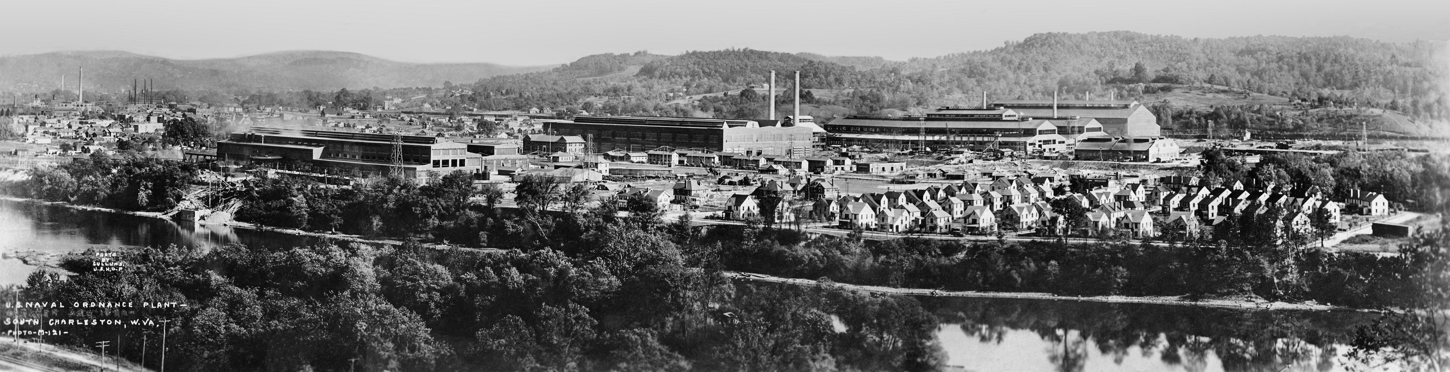 Panorama of the Naval Ordnance Plant (center). Armor Park, nestled between MacCorkle Avenue and the Kanawha River, is at right. Armor Park provided homes for 85 families.