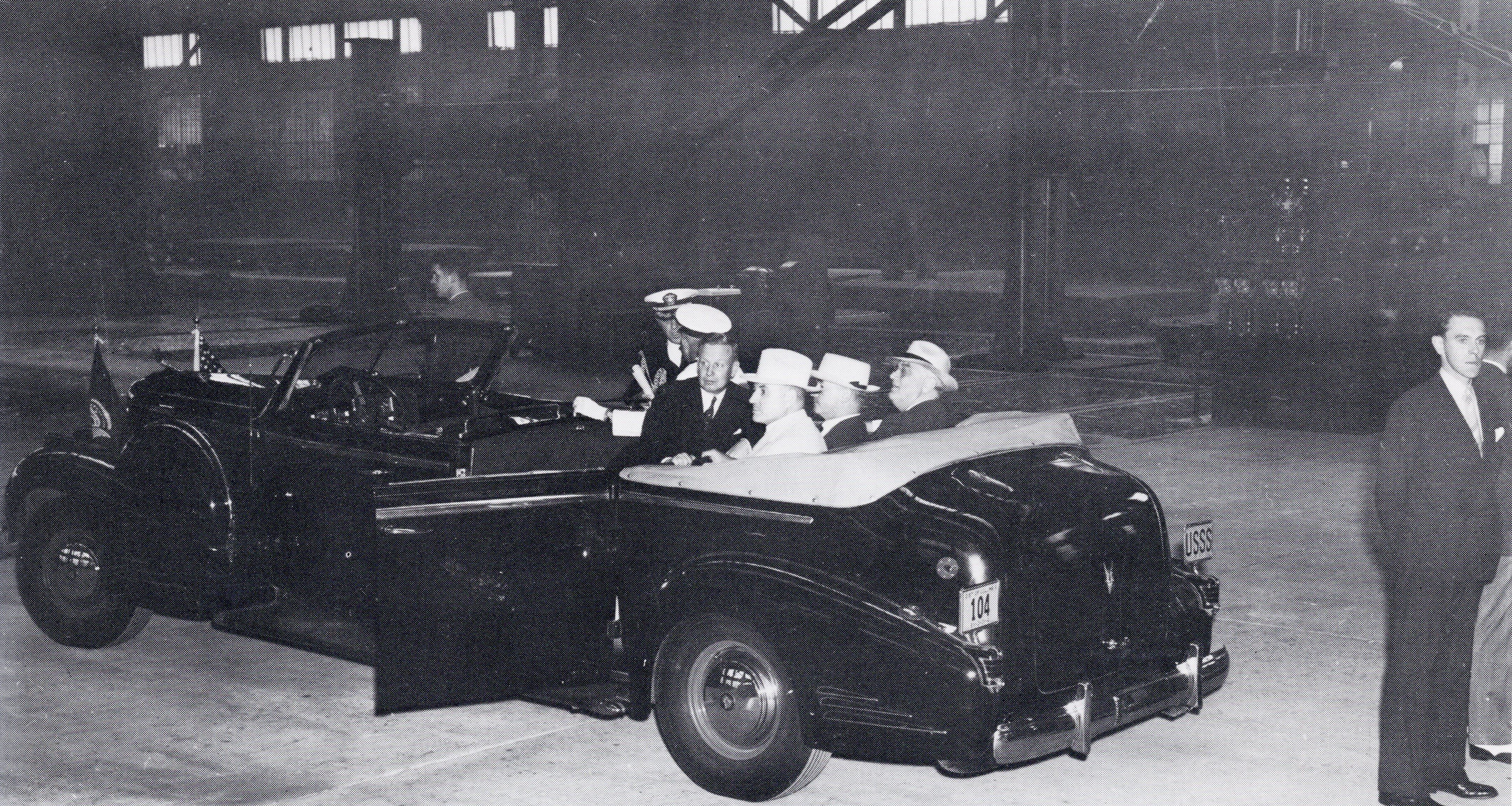 "President Franklin D. Roosevelt tours the Ordnance Plant on Sept. 3, 1940. The car was made especially for the President. The ""USSS"" on the license plate stands for ""United States Secret Service."""