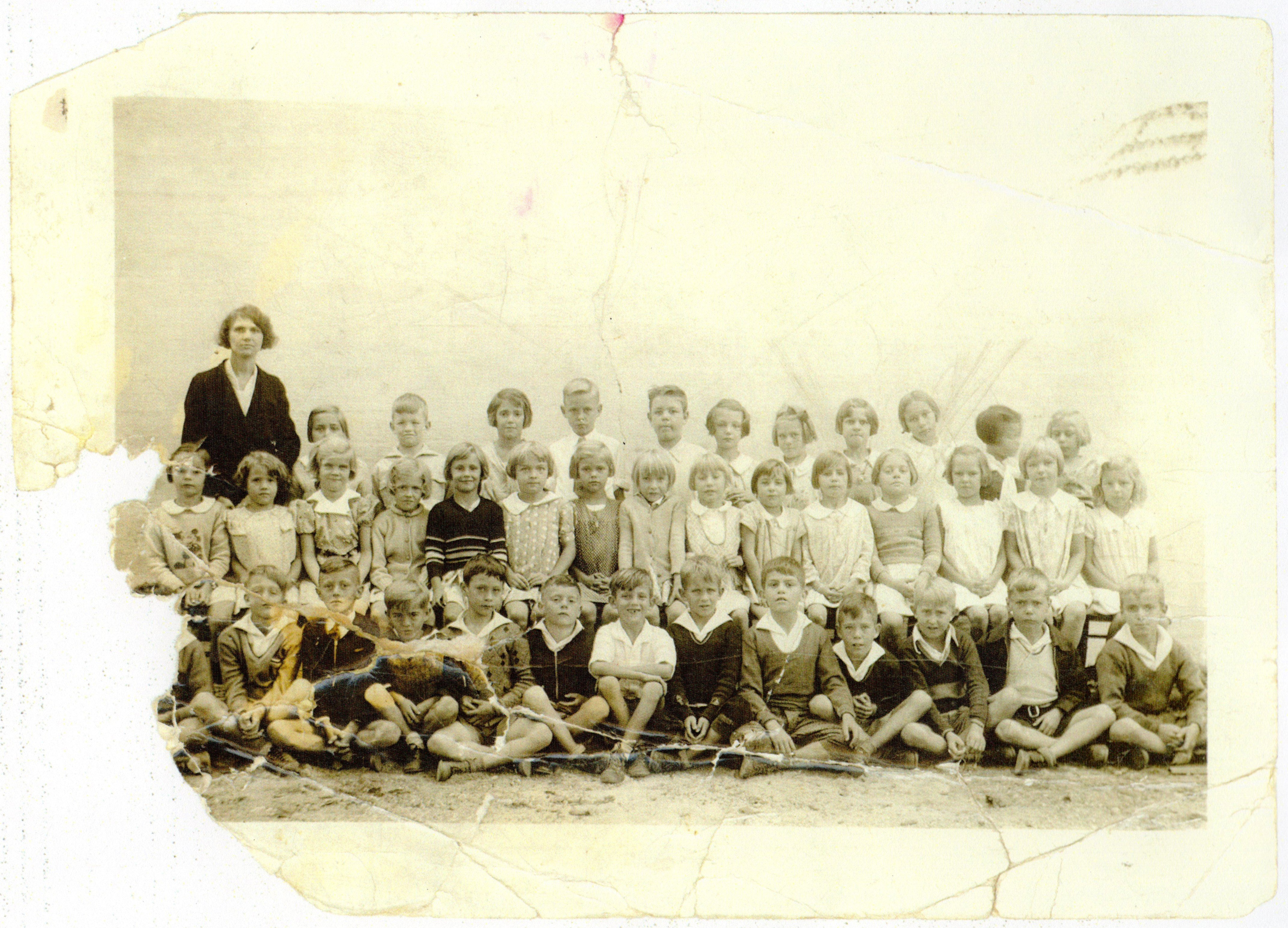 An elementary grade-level class of Armor Park School from 1934-1935. The school, which was administered by the U.S. Navy at the cost of $2.00/year per student, included a full suite of athletic facilities, including baseball and football fields.