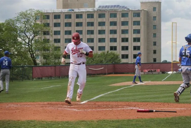 Kyle Schwarber scores a run at Sembower with Briscoe in background