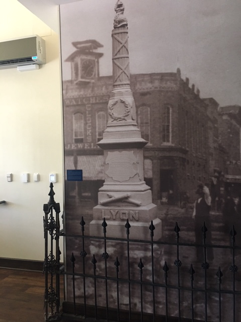 Photo of the Lyon Monument on the Square with the original Victorian fence