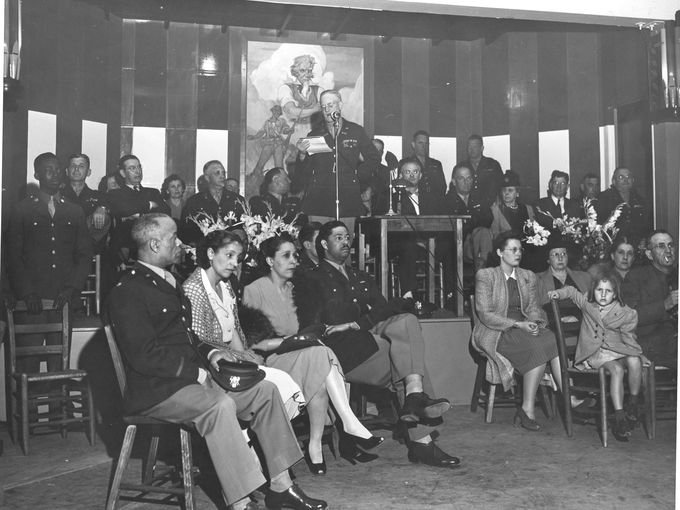 event in 1942 at the Mountain View Black Officers Club, a speech is being given.