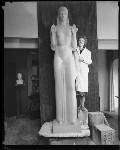 Ada May Sharpless standing proudly beside her 14 ft creation. Though she created other works of art through the P.W.A.P program, the Queen of Angels was her largest undertaking.