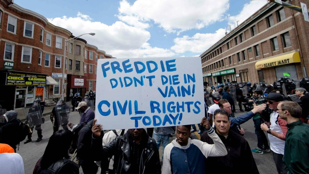 Peaceful protestors march for justice following the death of Freddie Gray