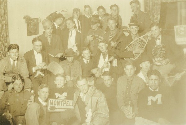 "Q.T.V. fraternity during Class of 1928 freshman year, ca. 1923. Members of the QTV fraternity jokingly pose with various props during Horace Brockway's freshman year. ""Brockway, Horace '28"" and ""Freshman year, the boys, QTV fraternity"" on back."