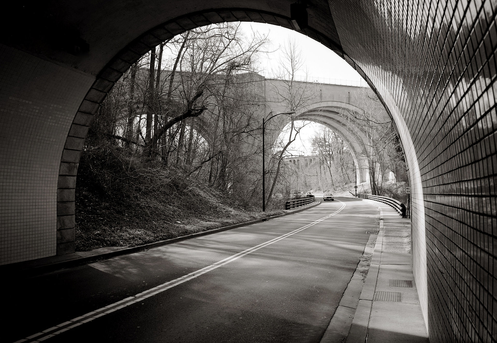 A view of the Duke Ellington Bridge from the Potomac Parkway tunnel, with the Taft Bridge in the distance. Courtesy of the HABS Report for the Rock Creek Parkway.