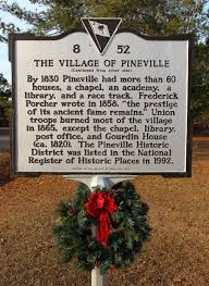The plaque added in 1992 when The Village of Pineville was added to the National Register of Historic Places.