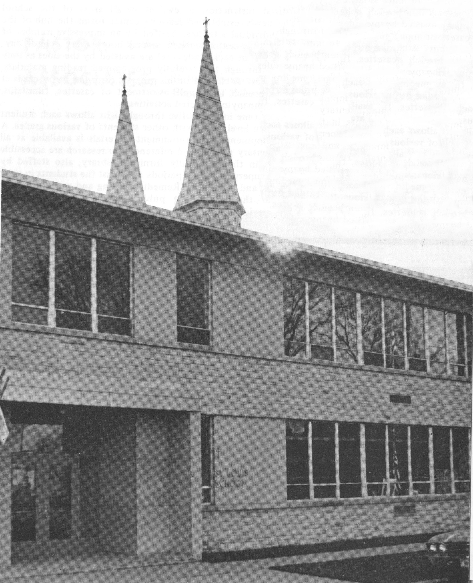 St. Louis School with the twin spires of the church in the background, c. 1970.