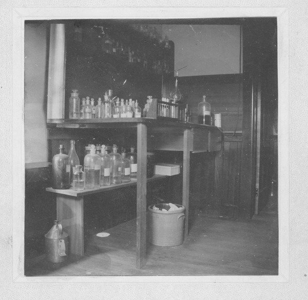 Laboratory bench and chemicals in the Insectary (also known as the Entomological Building), undated.