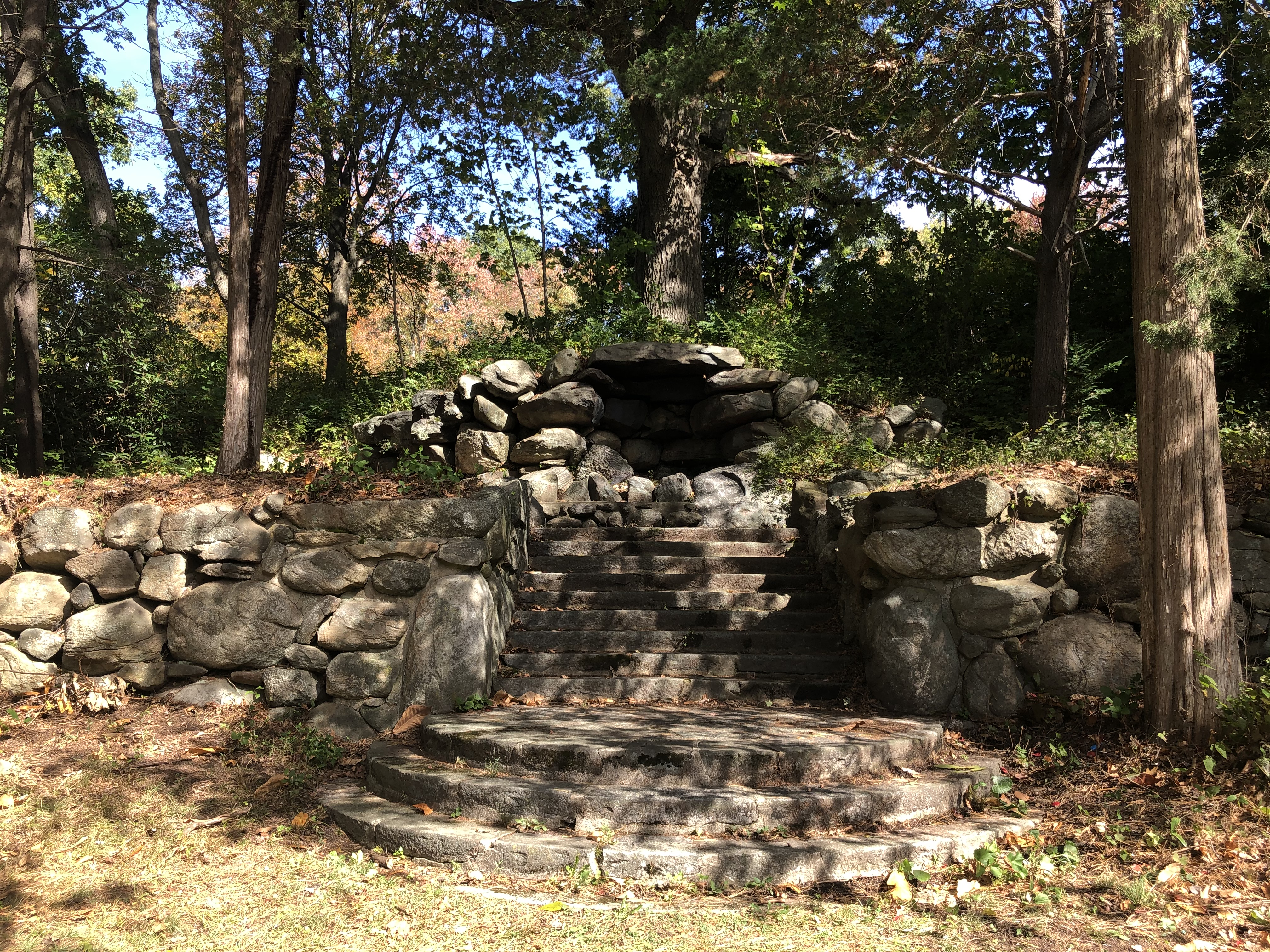 Steps leading up to a stone fireplace near Greenwood Avenue.