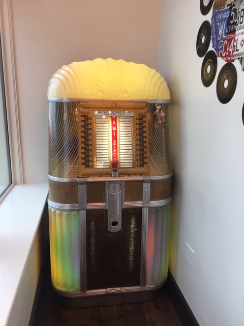 Play a song on this original Mother of All Plastic Jukebox!
