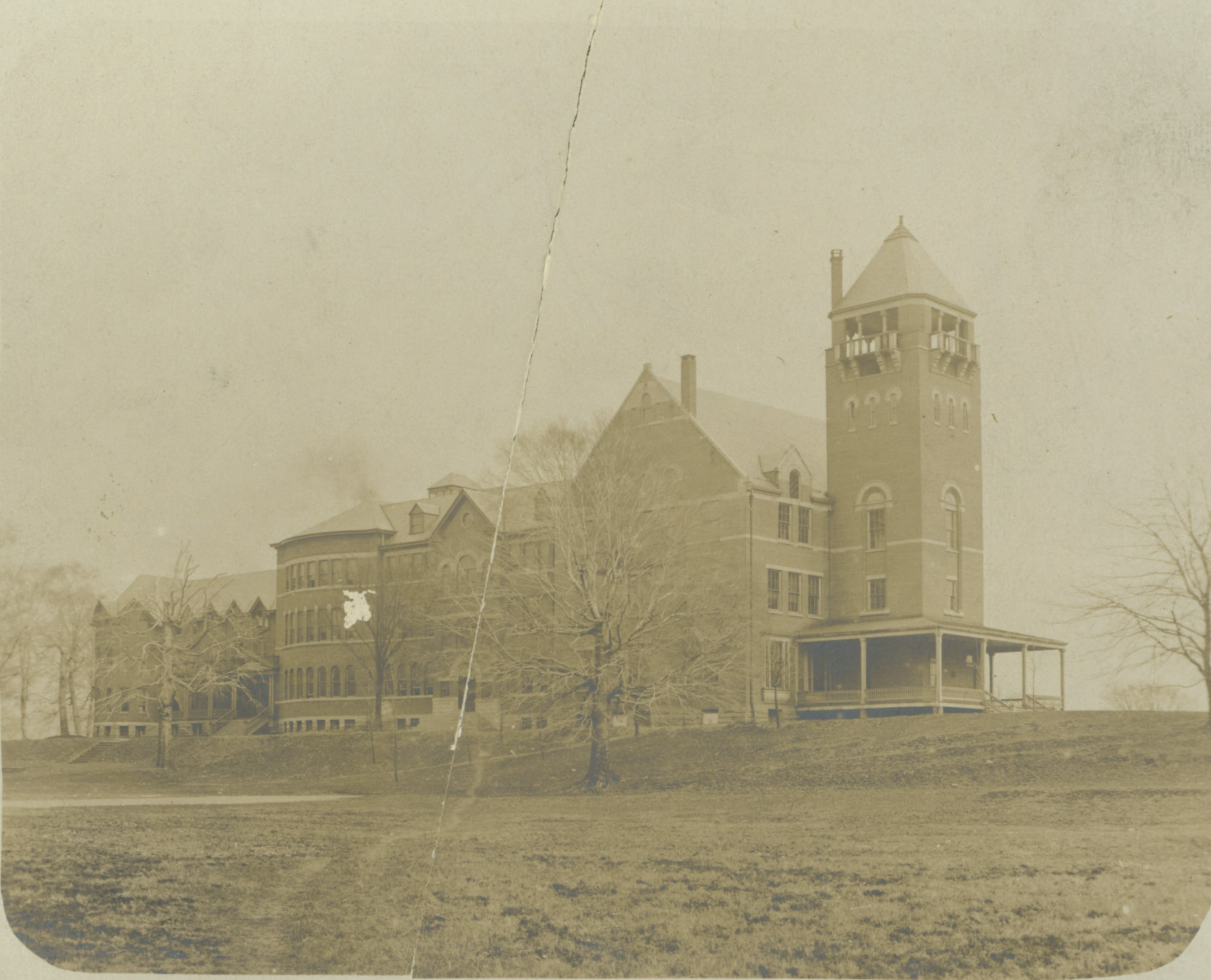 Old Main sometime between 1899 and 1905. Note the bell tower in front of the 1870 section.