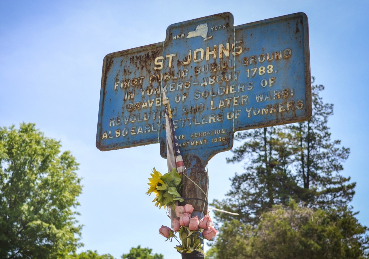 Historical marker identifying the St. John's portion of the cemetery