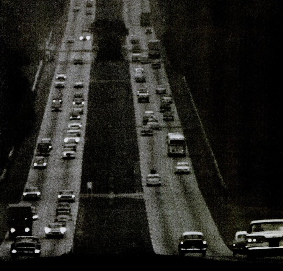 "A photo of cars driving along Route 40 featured in Life Magazine titled, ""Four Lanes to Trouble"" (December 8, 1963)."