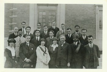 "Kenyon L. Butterfield, 1922. Caption of rear of photo says, ""College Cosmopolitan Club. 10 nationalities represented. About 1922"". Butterfield is in the front row center right."