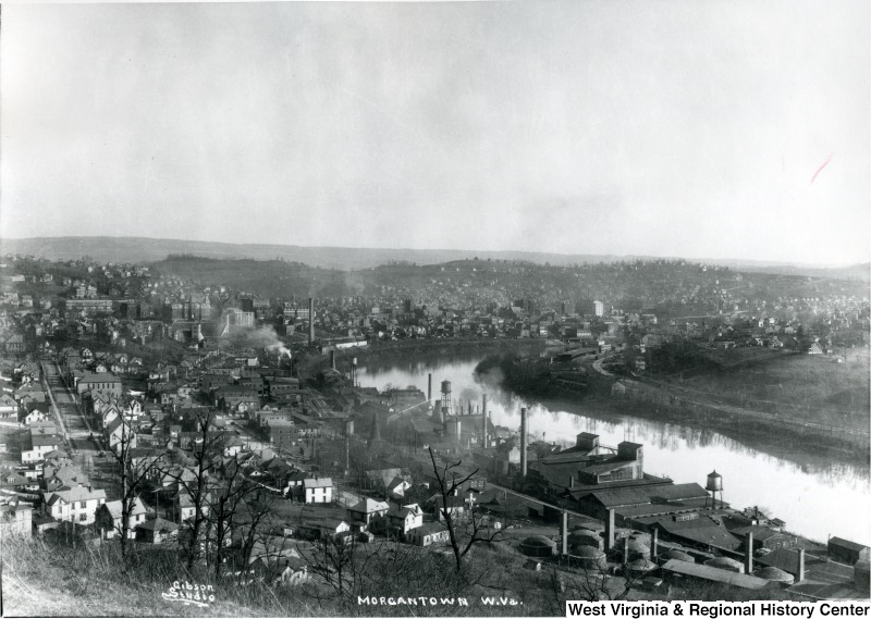 This view of Sunnyside shows the Morgantown Brick Company's location in the bottom righthand corner. The rounded kilns were easily distinguished amongst other industries on the river, such as glass factories. West Virginia and Regional History Center