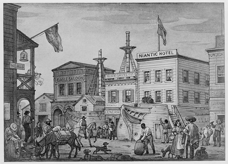 An illustration circa 1850 showing two of the Gold Rush ships that were hauled ashore and built upon while being converted to new use as public buildings. On the right, the ship Niantic is being converted into a hotel.