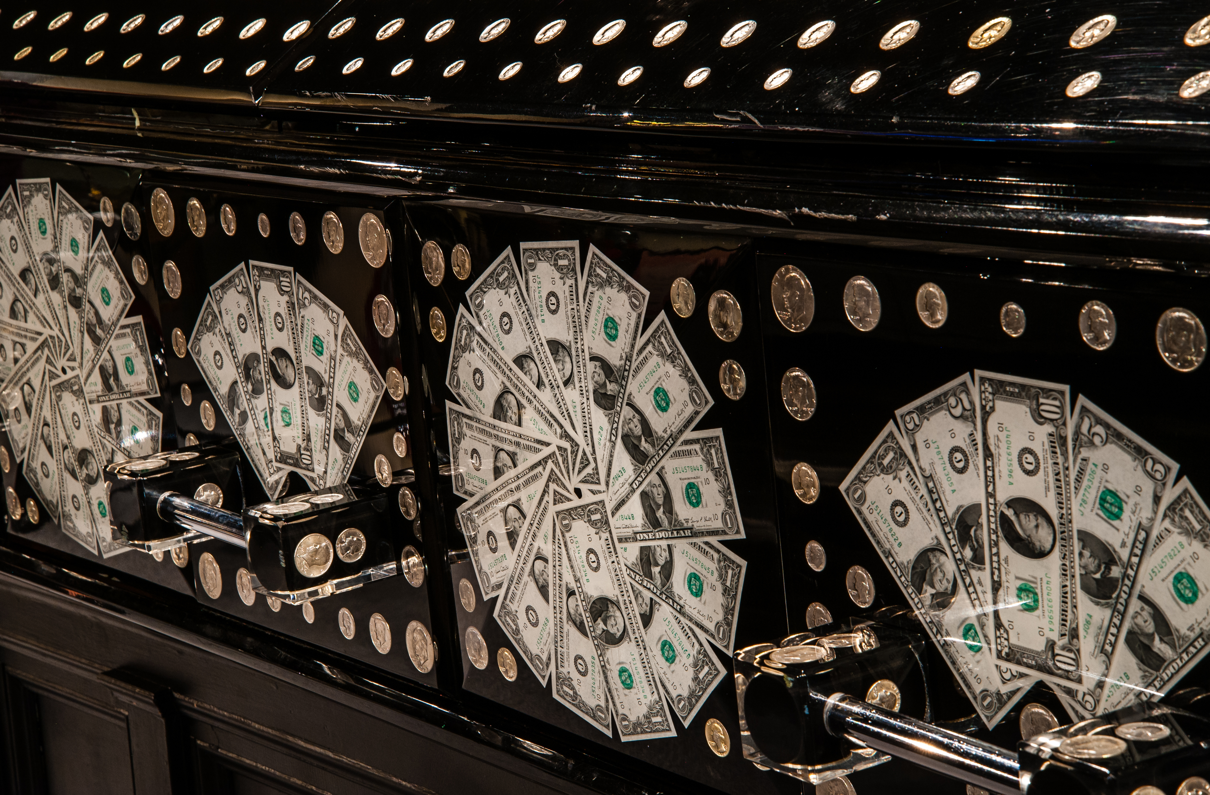 One of the more unique caskets on display is this one embedded with money. Image courtesy of the National Museum of Funeral History.