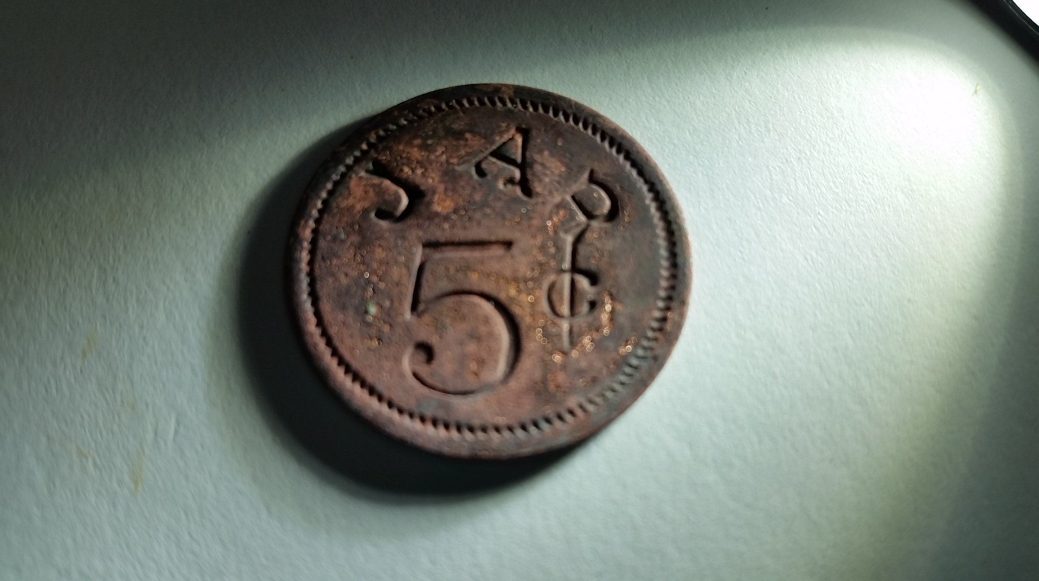 1880s merchant issued 5 cent token uncovered during the Mead's Tavern porch excavation.