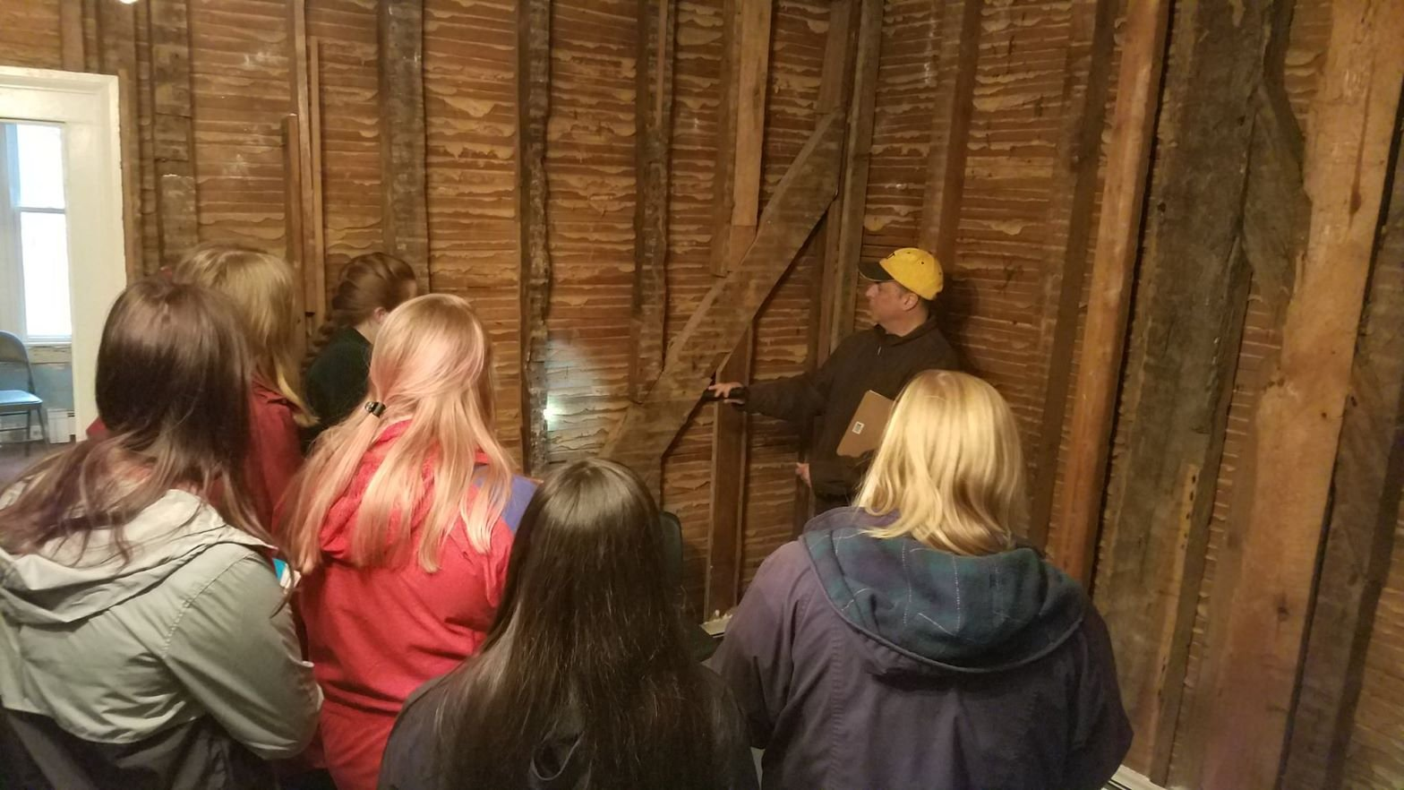 Liberty University history students viewing original architectural work inside Mead's Tavern.