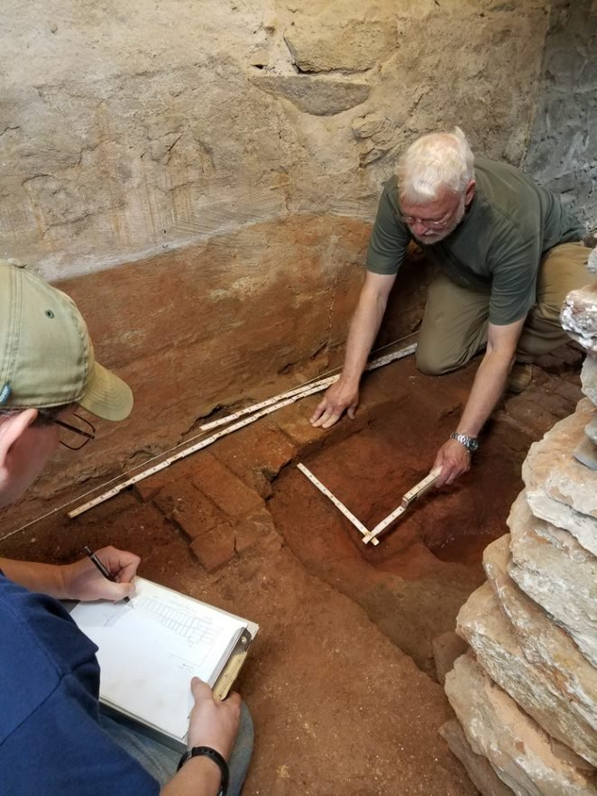 Liberty University archaeologists working inside the cellar at Mead's Tavern.
