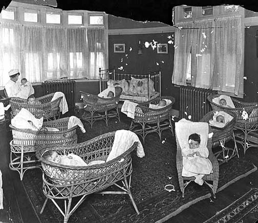 A group of newborn babies in the hospital around 1910