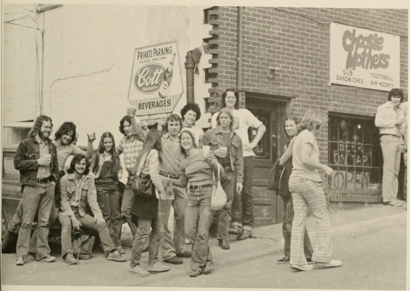 Sunnyside's restaurants and pubs began catering to student interests, changing the business makeup of the neighborhood. Here, students gather outside a pub in Sunnyside called Choosie Mothers. WVU Monticola, 1978.