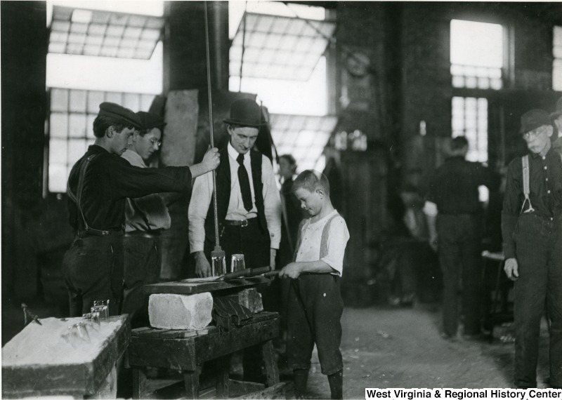 Lewis Hine photograph from 1908 of a child working in the Union Stopper Company factory. West Virginia and Regional History Center, WVU Libraries, and Library of Congress.
