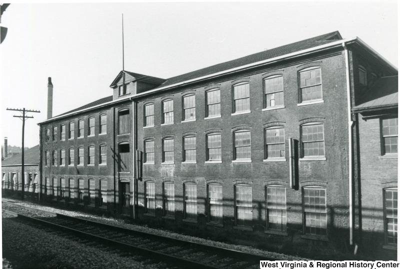 The original brick mill that later served as part of a glass factory complex. It was demolished in 1998. Photo courtesy of the West Virginia and Regional History Center, WVU Libraries.