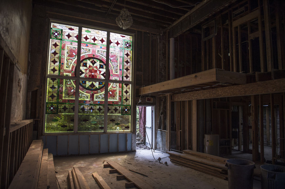 Efforts to renovate the building are continually being made in an effort to keep this part of history alive. Beautiful remnants of the era can still be found in the front facade and stained glass windows like this one.