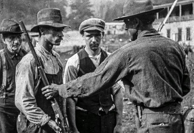 Miners surrender their rifles after Battle of Blair Mountain (1921)
