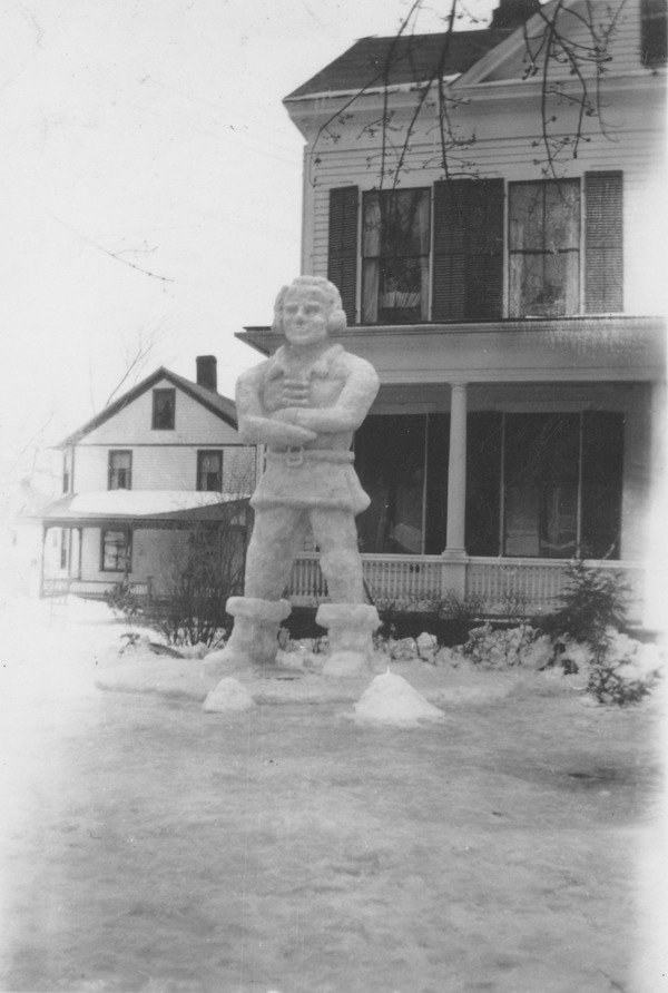 Winter Carnival snow sculpture of a Colonial man, ca. February 1941. A snow sculpture created for the traditional campus Winter Carnival depicts a Colonial man, possibly a Minuteman.