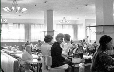 A photo of the inside of Bailey's Cafeteria, featuring all white customers.