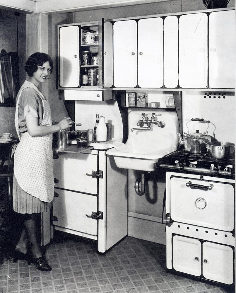 Early photo used in the first ad to sell apartment units. It's modern kitchen and the image of a wife sought to appeal to middle class families.