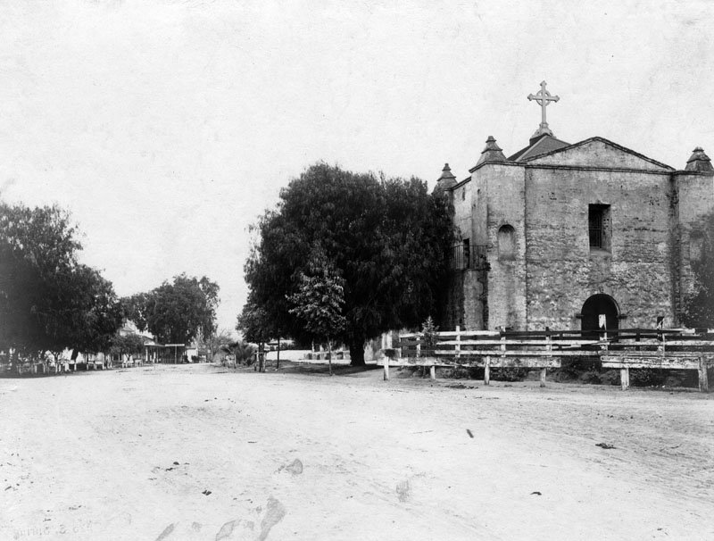 """Arcangel circa 1870. The unpaved road at left is El Camino Real (the King's Road""""), the 600-mile trail that connected all 21 missions, and California's first major overland commerce route."""