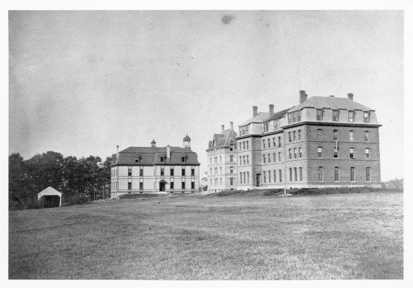 Original buildings at Massachusetts Agricultural College; South College, North College, and College Hall (r. to l.), ca. 1875. Phi Sigma Kappa was founded in North College, which was located near today's Machmer Hall.