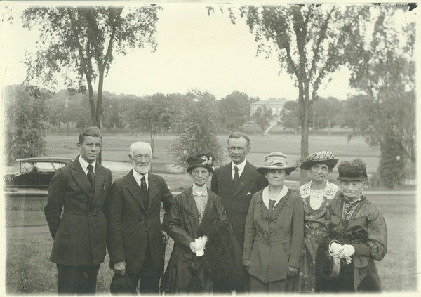 Barnes, Lincoln Wade (photographer). Kenyon L. Butterfield and family, 1922. Kenyon Butterfield is shown posing for a portrait with his family, which consists of a son, three older women and an older man, and his wife.