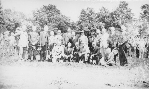 Cornerstone ceremony for Goodell Library and Thatcher Hall, November 3, 1934. President Hugh Potter Baker, Massachusetts Governor Joseph B. Ely and former President Kenyon L. Butterfield gather with members of the Board of Trustees, among others, dur