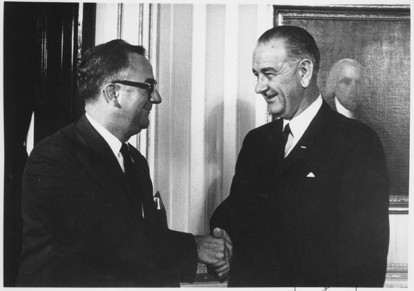 Oswald Tippo shakes hands with Lyndon B. Johnson, October 8, 1964.
