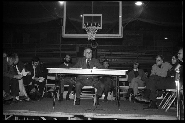 Drucker, Jeffrey (photographer). Oswald Tippo (Provost, UMass Amherst) speaks at open meeting with school administration, Curry Hicks Cage, regarding protests against war in Vietnam, ca. February 19, 1968. 