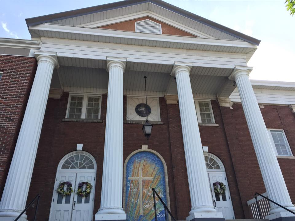 A closer view of the church's neo-classical facade and entryway. Courtesy of First Baptist Church.
